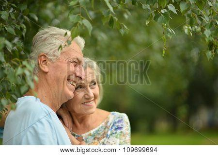 Mature couple on  walk  in summer