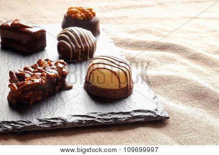 Assorted Bonbons On A Slate Plate