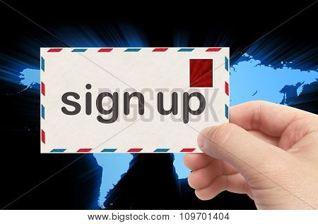 Hand Holding Envelope With Sign Up Word And World Background