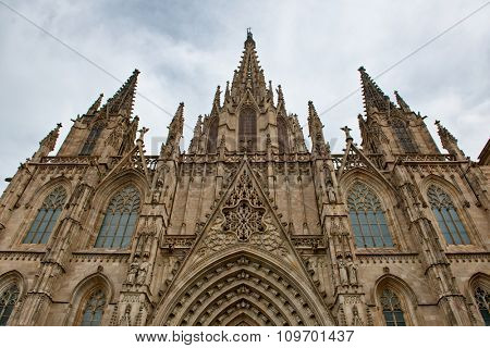 Exterior Gothic Facade of Ornate Barcelona Cathedral Against Overcast Sky, Barcelona, Spain