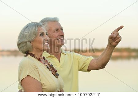 Happy senior couple  near river