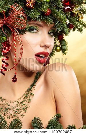 Christmas Winter Fashion Model Girl with Christmas tree hairstyle decorated with garland lights and baubles.