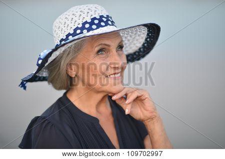 Senior woman near lake