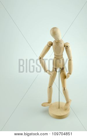 A Wooden Mannequin Doll Posing On White Background