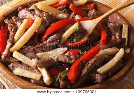 Peruvian Cuisine: Lomo Saltado Close-up On A Plate. Horizontal