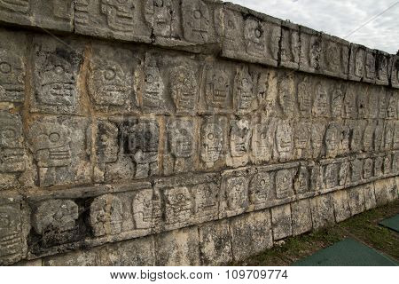 Wall of carved skulls, Mexico