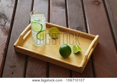 Drink On Wooden Tray With Ice And Condensation On Glass