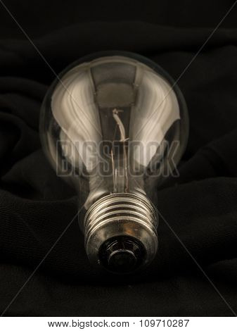 Lightbulb On Black Cloth