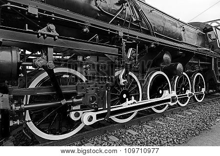 Black And White Detail And Close Up Of Huge Wheels At One Old Steam Locomotive 6