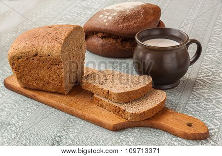 Mug With Milk And Rye Bread