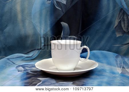 White Cup On A Blue Backdrop