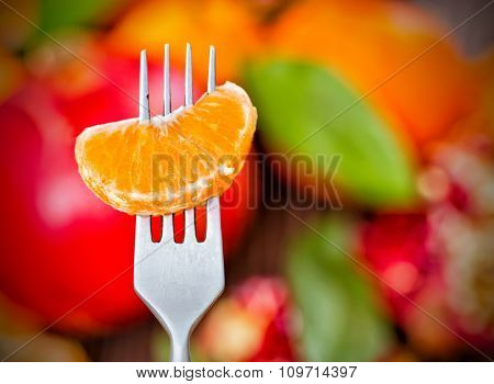 Tangerine Slice On Fork,  Bright Colored Background