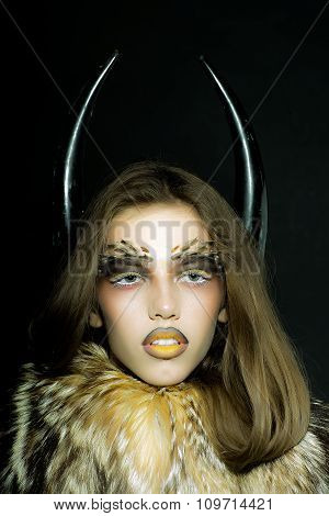 Woman In Coat And Horns