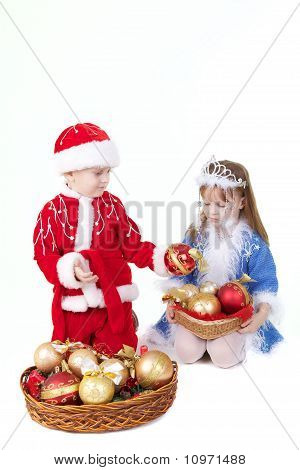 Little Girl And Boy In Christmas Clothes With Toys