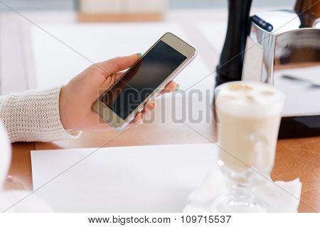 Customer holding a smartphone.