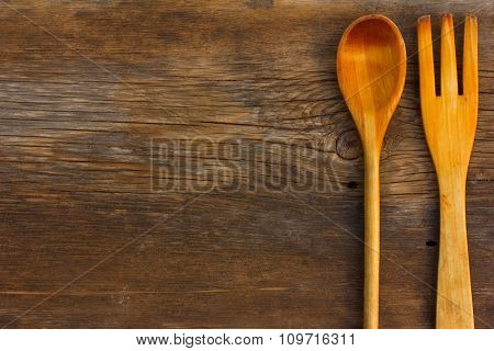 Wooden spoon and fork on barn board