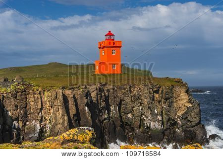 Orange Lighthouse At Seashore Of Grimsey Island Nearby Iceland, Summer Time