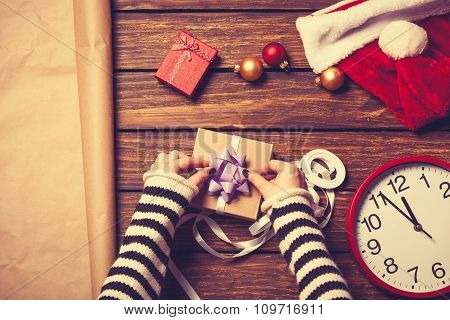 Female Hands And Christmas Gift