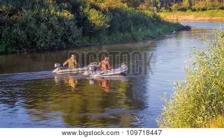 Fishermen On The River Float Boat
