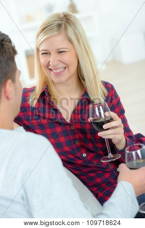 Couple at home drinking red wine