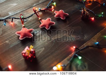 Handmade Red Stars And On The Wooden Table