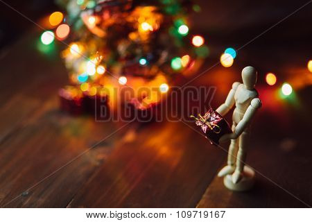 Wooden Hinged Mannequin With The Gift And The Chritsmas Tree