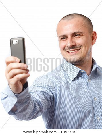 Businessman Taking Photos With Cellphone