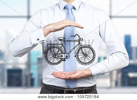 A Person In Formal Clothes Holds A Sketched Bicycle Between His Hands. A Modern Panoramic Office In