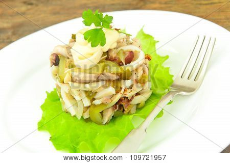 Healthy and Diet Food: Salad with Squid and Chicken.