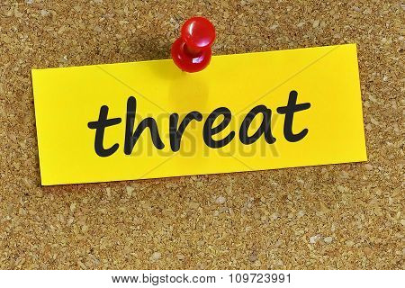Threat Word On Yellow Notepaper With Cork Background