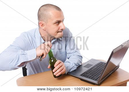 Businessman With Beer In The Office