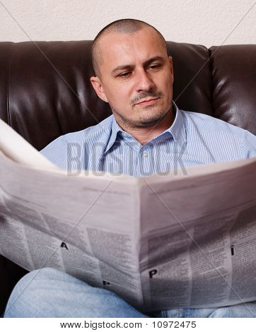 Young Man With Newspaper