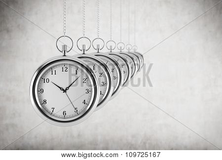 Pocket Watches In A Chain Are In The Line. Concrete Background. 3D Rendering