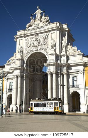 LISBON-PORTUGAL NOVEMBER 11, 2015:  View of the arch with a yellow tramway at The Praca do Comercio or Commerce Square and located in the city of Lisbon, Portugal.