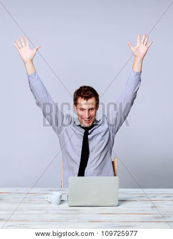Happy man working on laptop in the office