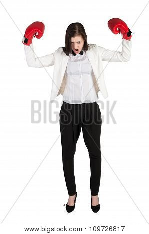 Angry businesswoman shouts in boxing gloves