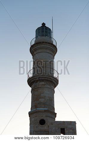 Historical Venetian lighthouse on sunset. Chania Crete.