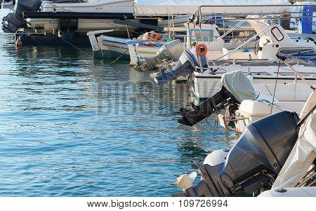 Several motor boats moored at the dock.