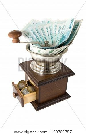 Depreciation Of Money - Brown Grinder With Russian Money On A White Background. ????????????? ?????
