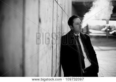 Handsome businessman smoking