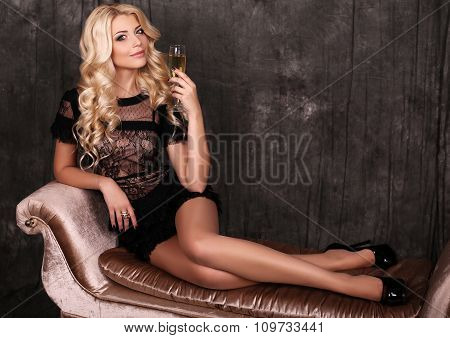 Beautiful Blond Woman In Elegant Dress,with Glass Of Champagne