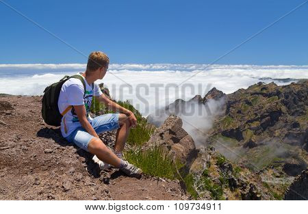 The Tourist On Madeira Has A Rest, Having Got On The Top Located Above Clouds