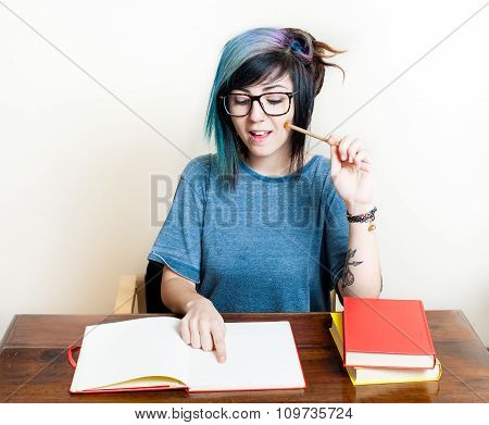 Young Happy Female Student With Books