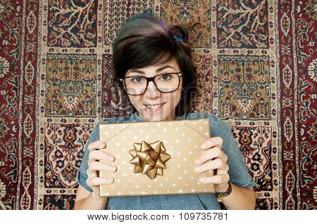 Pretty Young Teen Woman Cheerful With Gold Gift Pack