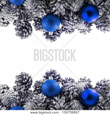 Silver pine cones Christmas decoration on white background