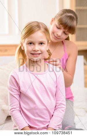 Pretty sisters having fun at home