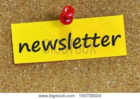 Newsletter Word On Yellow Notepaper With Cork Background