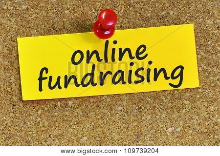Online Fundraising Word On Yellow Notepaper With Cork Background