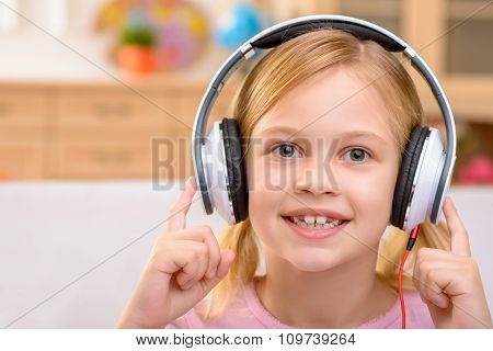 Vivacious little girl listening to music