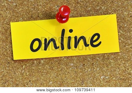 Online Word On Yellow Notepaper With Cork Background